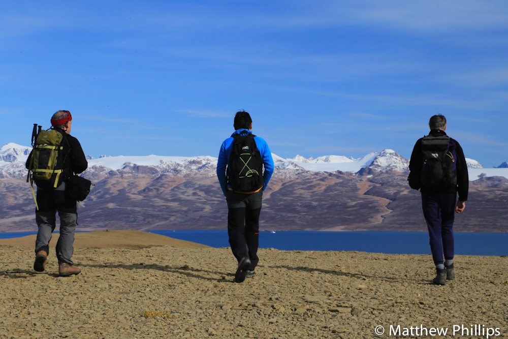 the trio approaching the last summit, hurry fjord and Liverpool land in the background.