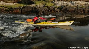 Doc Jerry battling tidal rapids, Lochmaddy, Isle of North Uist.